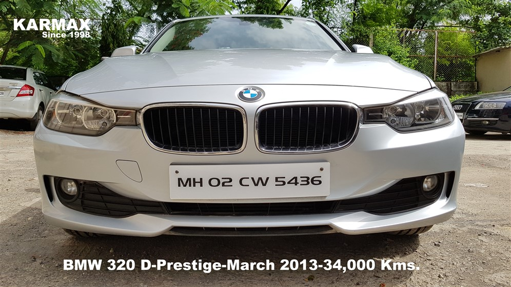 white bmw 320d prestige side view